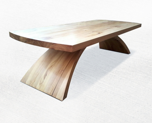 Ceeder wooden coffee table with curved base and top with ends curved