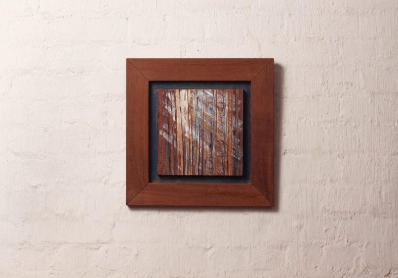 Semi abstract artwork of light through trees out of veneer and acrylic in wooden frame