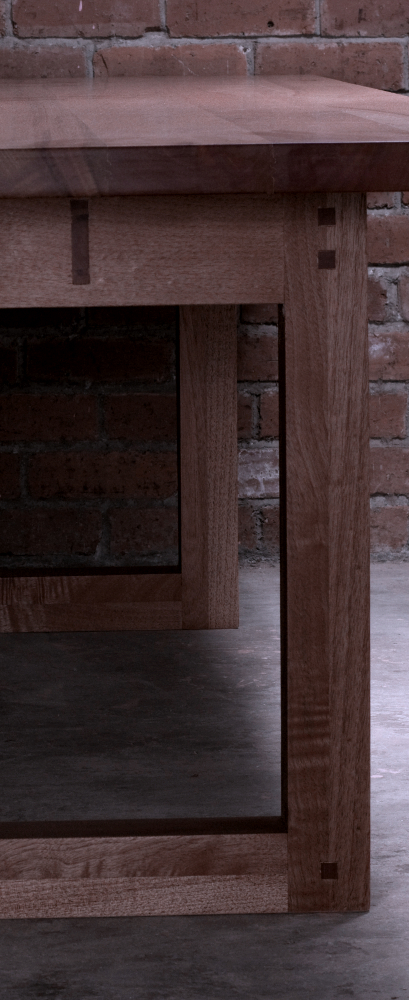 End detail of Bemu linear cedrela wooden table with exposed joinery